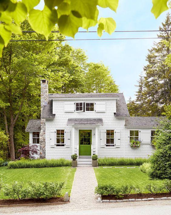 White cottage with green door - Tiny Cottage In Maine Tour
