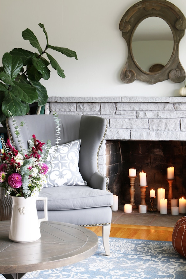 Candles in Fireplace/ Click through to see a fall house tour of this small white brick cottage with eclectic coastal farmhouse style.