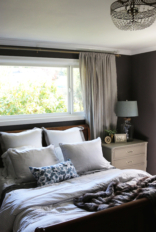Dark plum walls in cozy small bedroom! Sources, bedding and details are in the post.