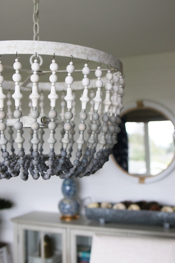 Gray Ombre Wood Beaded Chandelier - Click through to see a fall house tour of this small white brick cottage with eclectic coastal farmhouse style.