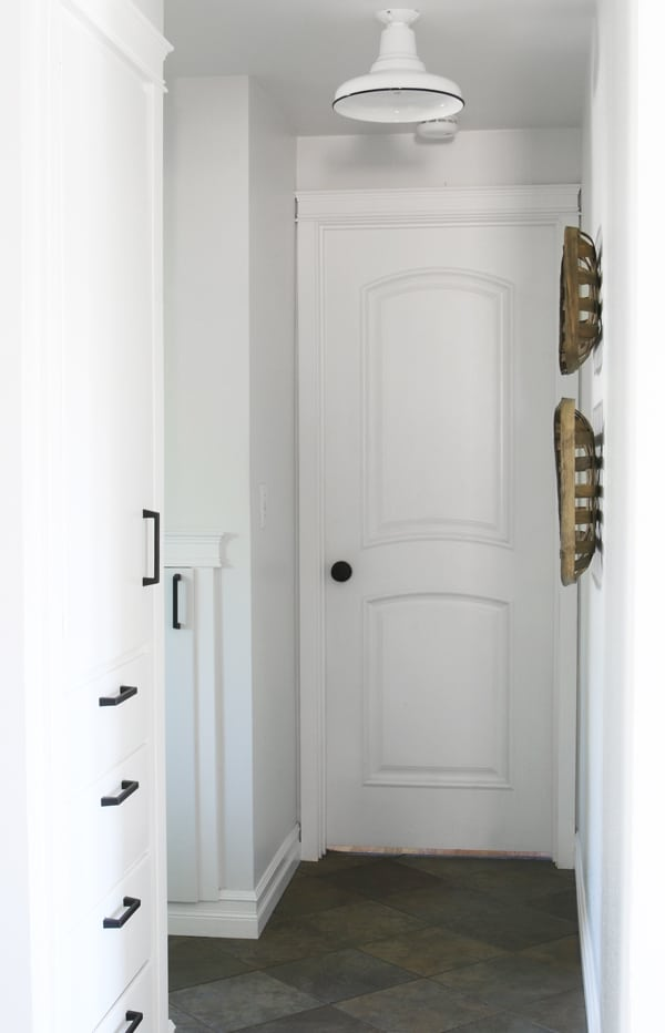 white hallway - built ins with black hardware