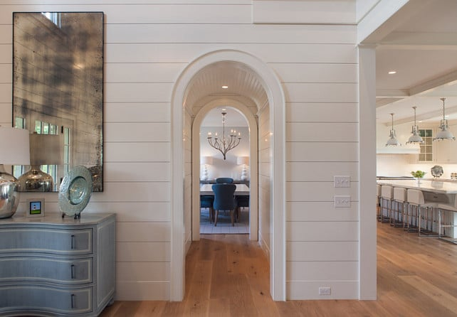 Arched hallway with shiplap planking