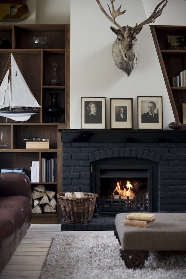 living room brick fireplace masculine and moody rooms get the look the inspired room 12841