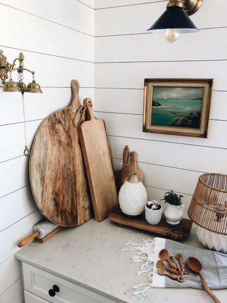 Pretty kitchen + wood cutting boards + diffuser